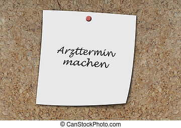 Arzttermin machen written on a memo - Arzttermin machen...