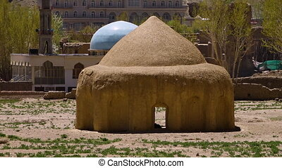As single mud hut. - Positioned in front of the caves at...