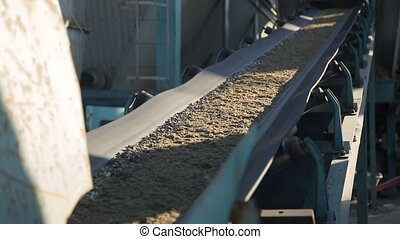 As the conveyor belt moves to the fine gravel factory floor.