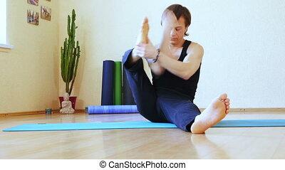 Asana Handstand in room - In room on floor man doing Asana...