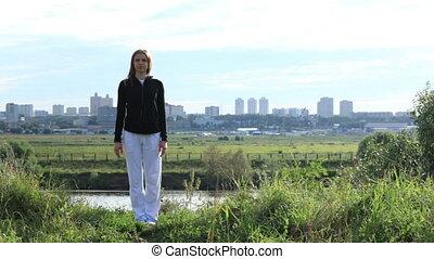 Asana pose 1 - Young woman making asana pose in the park