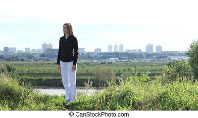 Asana pose 2 - Young woman making asana pose in the park