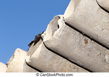 asbestos cement pipes against the blue sky
