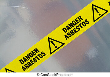 Asbestos warning sign - Danger Asbestos yellow warning tape...