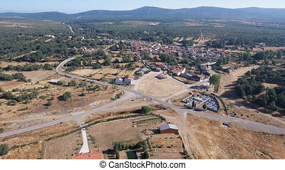 Ascending camera over small village in Castilla, Spain -...