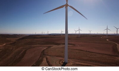 Ascending in front of windmill - Aerial view ascending in...