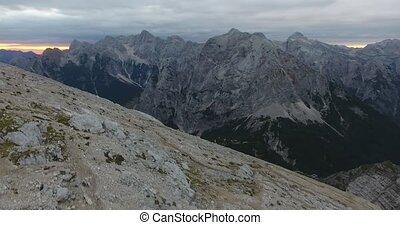 Ascending mountain slope at sunrise. Mala Mojstrovka in...