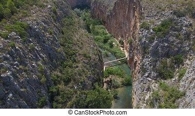 Ascending over deep gorge and suspension bridges in Chulilla...