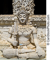 Ascetic with sai statue in Traditional Thai style molding art which is in Wat Mingmuang (Nan-Thailand)