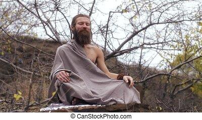 Ascetic yogi sitting in meditation