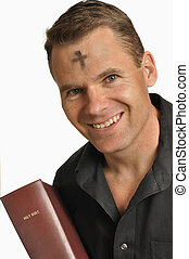 Ash Wednesday - Smiling man with mark of ashes on forehead...