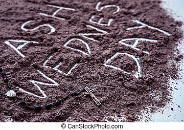 Ash wednesday word written in ash and christian cross symbol...