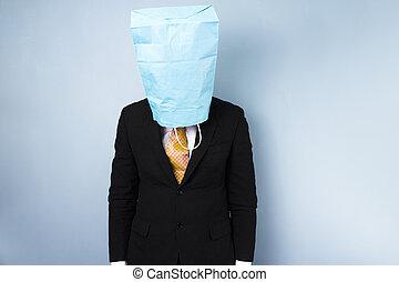Ashamed businessman with bag over his head