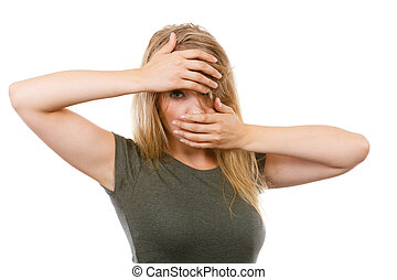 Ashamed embarrassed blonde woman with hands on face