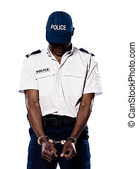 Ashamed policeman with handcuffs - Hand cuffed police...