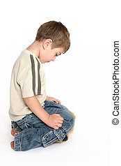 Ashamed - A toddler bows his head in shame.