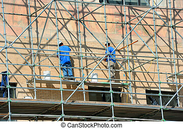 Asheville Government Building Repairs - Two men stand on ...