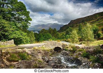 Traditional stone Ashness Bridge in English Lake District