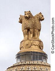 Ashoka Chakra on top of Vidhana Sabha in Bangalore. Buddhist wheels with twenty-four spokes, four lions and horses make the Indian national symbol.