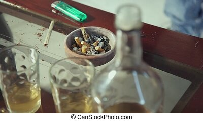 Ashtray Liquor Bottle Drugs Cigarettes And Joints On Home...