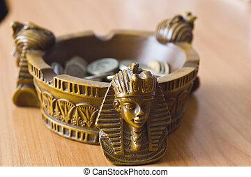 Ashtray with money