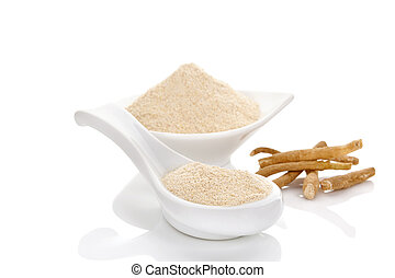 Ashwagandha powder in spoon with roots. Isolated on white....