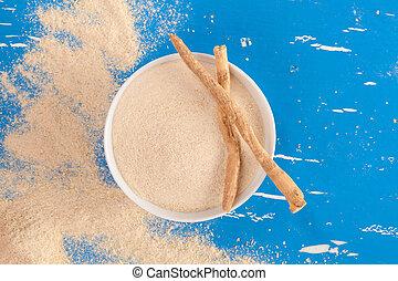 Ashwagandha supplement. - Ashwagandha root and powder...