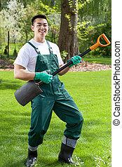 asiático, jardinero, tener diversión, en, jardín