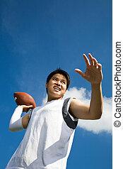 asiático, jogador de futebol