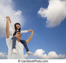 asiático, padre e hija, debajo, cloudfield