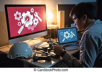 asiático, técnico, ingeniero, reparación, zángano, usar la computadora portátil