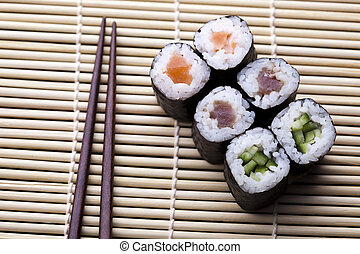 Asia and food on sushi - Japanese sushi seafood rolls with...