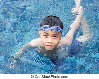 Asia boy kid child nine years old in swimming pool. Outdoor...