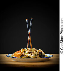 Asia glass noodles, prawn and vegetables, black background