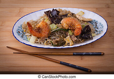 Asia Glass noodles, prawn and vegetables on bamboo board