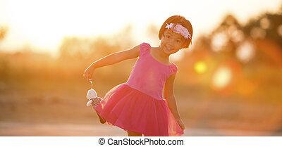Asia Little girl at sunset