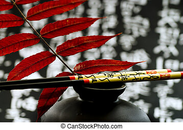 Still life asian style with red leaf and chinese background