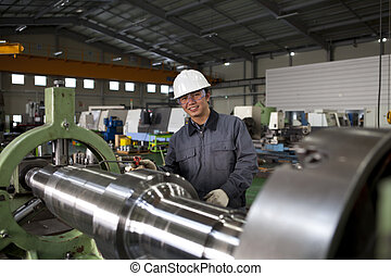 asia technician at tool workshop
