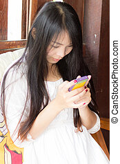 Asia Woman Using Mobile Phone  At Home