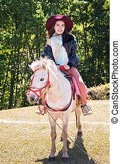 Asia women on horseback