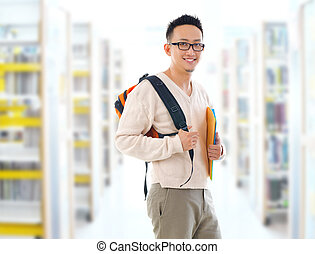 Asian adult student in library
