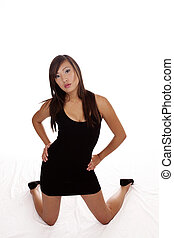 Asian American Teen Kneeling In Black Dress