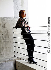 Asian American Woman Leaning On Cables Concrete Wall