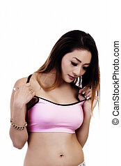 Asian American Woman Looking Down Pink Sports Top