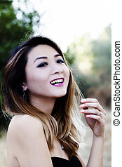 Asian American Woman Outdoors In Bare Shoulder Dress Smiling