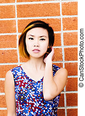 Asian American Woman Portrait Red Brick Wall
