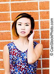 Asian American Woman Portrait Red Brick Wall