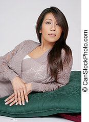 Asian american woman reclining