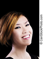 Asian American Woman Smiling Portrait Against Dark Background