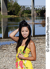 Asian American Woman Yellow Dress River Smiling